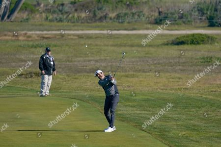 Ray Romano hits a ball on the 12 fairway of the Monterey Peninsula County Club Shore Course during the second round of the AT&T Pebble Beach National Pro-Am golf tournament, in Pebble Beach, Calif