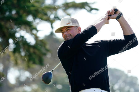 Josh Duhamel follows his shot from the 17th tee of the Monterey Peninsula County Club Shore Course during the second round of the AT&T Pebble Beach National Pro-Am golf tournament, in Pebble Beach, Calif