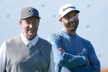Wayne Gretzky, left, and Dustin Johnson wait on the sixth green of the Monterey Peninsula County Club Shore Course during the second round of the AT&T Pebble Beach National Pro-Am golf tournament, in Pebble Beach, Calif