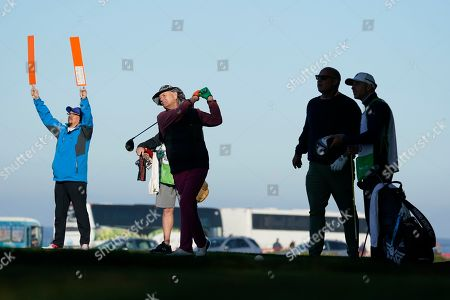 Bill Murray follows his drive from the 12th tee of the Monterey Peninsula Country Club Shore Course during the second round of the AT&T Pebble Beach National Pro-Am golf tournament, in Pebble Beach, Calif