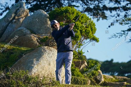 Huey Lewis hits from the 11th tee of the Monterey Peninsula Country Club Shore Course during the second round of the AT&T Pebble Beach National Pro-Am golf tournament, in Pebble Beach, Calif