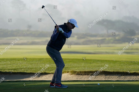 Peyton Manning hits from the 12th tee of the Monterey Peninsula County Club Shore Course during the second round of the AT&T Pebble Beach National Pro-Am golf tournament, in Pebble Beach, Calif