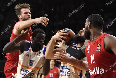 Munich's Danilo Barthel (L-R) in action with Valencia's Maurice Ndour, Valencia's Bojan Dubljevic and Munich's Greg Monroe during the Euroleague basketball match between Bayern Munich and Valencia Basket in Munich, Germany, 07 February 2020.