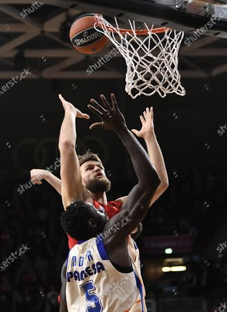 Stock Photo of Valencia's Maurice Ndour (L) in action against Munich's Danilo Barthel during the Euroleague basketball match between Bayern Munich and Valencia Basket in Munich, Germany, 07 February 2020.
