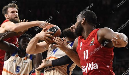 Stock Picture of Munich's Danilo Barthel (L-R) in action with Valencia's Maurice Ndour, Valencia's Bojan Dubljevic and Munich's Greg Monroe during the Euroleague basketball match between Bayern Munich and Valencia Basket in Munich, Germany, 07 February 2020.