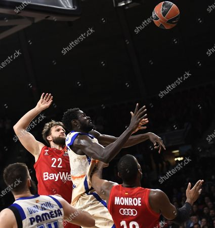 Stock Image of Munich's Danilo Barthel (L) in action against Valencia's Maurice Ndour during the Euroleague basketball match between Bayern Munich and Valencia Basket in Munich, Germany, 07 February 2020.