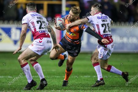 Stock Photo of CastlefordÕs Danny Richardson is tackled by WiganÕs Harry Smith.