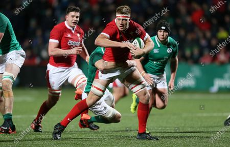 Ben Carter of Wales is tackled by David McCann of Ireland.