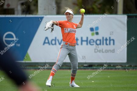 Sam Houston State outfielder Megan McDonald (9) throws a ball back to the infield after fielding a base hit during an NCAA softball game against George Mason in Deland, Fla