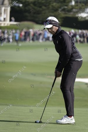 Condoleezza Rice, ex Secretary of State putts on the 18th green