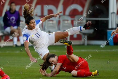 Stock Photo of Costa Rica forward Raquel Rodriguez, top, is knocked over by Canada defender Allysha Chapman during the first half of a CONACAF women's Olympic qualifying soccer match, in Carson, Calif
