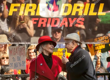 Two-time Oscar winner Jane Fonda, 82, left, and writer Norman Lear, 97, lead a Fire Drill Fridays rally, calling for action to address climate change at Los Angeles City Hall . A half-century after throwing her attention-getting celebrity status into Vietnam War protests, Fonda is now doing the same in a U.S. climate movement where the average age is 18