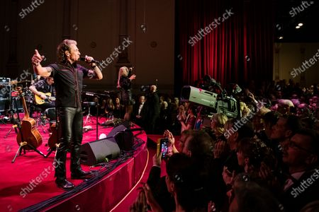 Stock Photo of Peter Maffay (L) performs during the SemperOpernball 2020 in the Semperoper Opera House in Dresden, Germany, 07 February 2020. The annual event, now in its fifteenth year, is held under the motto 'Rushing like a fairy tale - Dresden celebrates'.