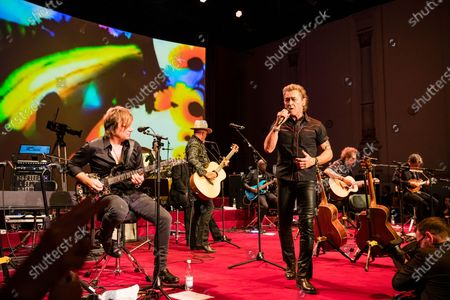 Stock Image of Peter Maffay (C-R) performs during the SemperOpernball 2020 in the Semperoper Opera House in Dresden, Germany, 07 February 2020. The annual event, now in its fifteenth year, is held under the motto 'Rushing like a fairy tale - Dresden celebrates'.