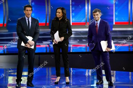 Stock Image of ABC World News Tonight Anchor David Muir, left, addresses members of the audience while standing with ABC News Live Anchor Linsey Davis, center, and ABC Chief Anchor George Stephanopoulos, right, before the start of a Democratic presidential primary debate hosted by ABC News, Apple News, and WMUR-TV at Saint Anselm College in Manchester, N.H