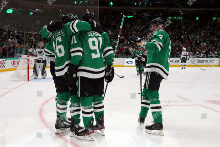 Dallas Stars, including center Joe Pavelski (16), center Tyler Seguin (91) and defenseman John Klingberg (3), celebrate a first-period goal by Pavelski in the first period during an NHL hockey game against the Minnesota Wild, in Dallas