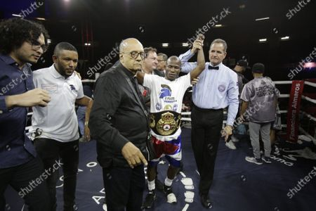 Daniel Matellon (C) of Cuba celebrates his victory against Erik Lopez of Mexico for the World Boxing Association (WBA) light flyweight title during the WBA KO to Drugs international boxing festival at the Roberto Duran Arena  in Panama City, Panama, 07 February 2020.