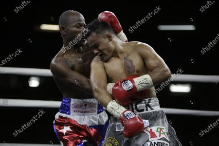 Daniel Matellon (L) of Cuba in action against Erik Lopez (R) of Mexico for the World Boxing Association (WBA) light flyweight title during the WBA KO to Drugs international boxing festival at the Roberto Duran Arena  in Panama City, Panama, 07 February 2020.