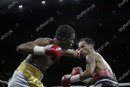 Luis Concepcion (R) of Panama in action against Rober Barrera (L) of Colombia for the World Boxing Association (WBA) interim flyweight title during the WBA KO to Drugs international boxing festival at the Roberto Duran Arena  in Panama City, Panama, 07 February 2020.