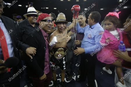 Luis Concepcion (C) of Panama cemlebrates his win against Rober Barrera of Colombia for the World Boxing Association (WBA) interim flyweight title during the WBA KO to Drugs international boxing festival at the Roberto Duran Arena  in Panama City, Panama, 07 February 2020.