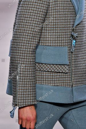 Model on the catwalk, jacket detail