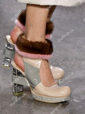 Stock Photo of Model on the catwalk, shoe detail