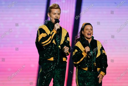 Stock Photo of Hosts Joel Creasey (L) and Myf Warhurst speak during the 2020 Eurovision - Australia Decides final at the Gold Coast Convention and Exhibition Centre on the Gold Coast, Queensland, Australia, 08 February 2020. The Eurovision Song Contest (ESC) 2020, the 65th edition of the event, is held from 12 to 16 May 2020 in the city of Rotterdam, The Netherlands. Australia, where the ESC is very popular since 1974, sent its first participant for the ESC's 60th jubilee event in 2015.
