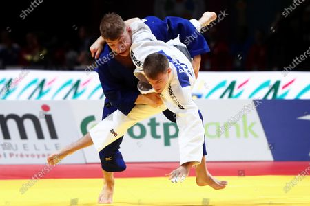 Stock Photo of Lukas Reiter (white) of Austria in action against Schamil Dzavbatyrov (blue) of Germany during the men's -73kg category second round bout of the Paris Grand Slam judo tournament in Paris, France, 08 February 2020.