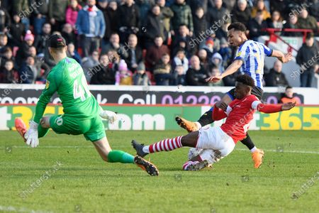 Stock Image of Jacob Murphy of Sheffield Wednesday shot is blocked by Clarke Oduor of Barnsley.