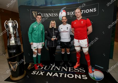 Stock Photo of Ireland vs Wales. Ireland captain Jonathan Sexton, Niamh Cullen of Guinness, referee Romain Poite and Wales' captain Alun Wyn Jones during the coin toss