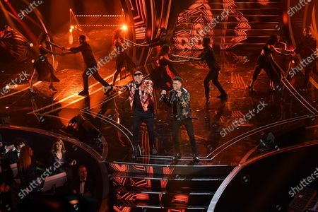 Stock Image of Members of Cuban band Gente De Zona, Alexander Delgado (L) and Randy Malcom Martinez (R) perform on stage at the Ariston theatre during the 70th Sanremo Italian Song Festival, Sanremo, Italy, 08 February 2020. The festival runs from 04 to 08 February.