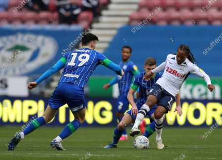 Stock Picture of 8th February 2020; DW Stadium, Wigan, Greater Manchester, Lancashire, England; English Championship Football, Wigan Athletic versus Preston North End; Daniel Johnson of Preston North End controls the ball under pressure from Michael Jacobs and Kieffer Moore of Wigan Athletic