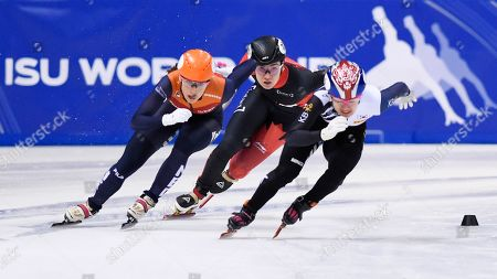 Canada's Courtney Lee Sarault, center rear and second place, Korea's Kim Ji-yoo, right and first place, and third placed Netherlands' Suzanne Schulting, left, compete in the women's 1000 meters final during the World Cup short track speed skating championship in Dresden, eastern Germany