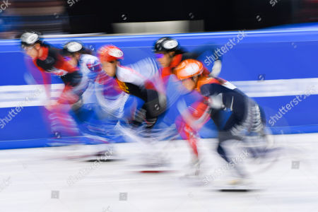 Netherlands' Suzanne Schulting, right, China's Zhang Yuting, center, Canada's Alyson Charles, second right, Russia's Ekaterina Efremenkova, second left, and Courtney Lee Sarault, left, compete in the heats of the women's 1000 meters race during the World Cup short track speed skating championship in Dresden, eastern Germany