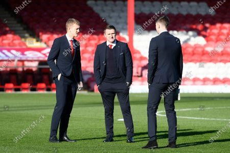 Robbie Keane with Middlesbrough players on the pitch on arrival ahead of the EFL Sky Bet Championship match between Brentford and Middlesbrough at Griffin Park, London