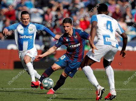 Levante's midfielder Enir Bardhi (C) vies for the ball with Leganes' defender Kenneth Omeruo (R) and midfielder Roque Mesa (L) during the Spanish LaLiga match between Levante UD and CD Leganes at Ciudad de Valencia Stadium, in Valencia, eastern Spain, 08 February 2020.