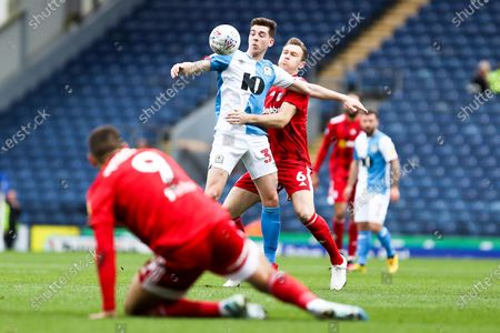 Stock Photo of Blackburn Rovers midfielder Joseph Rankin-Costello challenged by Fulham midfielder Kevin McDonald during the EFL Sky Bet Championship match between Blackburn Rovers and Fulham at Ewood Park, Blackburn