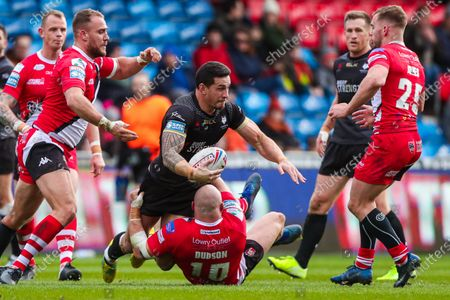 Toronto's Sonny-Bill Williams is tackled by Salford's Gil Dudson.