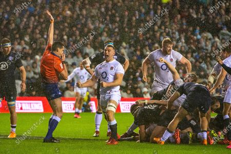 Ben Earl (#21) (Saracens) of England celebrates after seeing Ellis Genge (#17) (Leicester Tigers) of England score a try during the Guinness Six Nations match between Scotland and England at the BT Murrayfield Stadium, Edinburgh