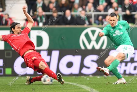 Bremen's Maximilian Eggestein (R) in action against Union's Neven Subotic (L) during the German Bundesliga soccer match between SV Werder Bremen and FC Union Berlin in Bremen, Germany, 08 February 2020.