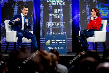 """Pete Buttigieg, Stephanie Ruhle. Democratic presidential candidate former South Bend, Ind., Mayor Pete Buttigieg accompanied by host Stephanie Ruhle of NBC News and MSNBC speaks at """"Our Rights, Our Courts"""" forum at New Hampshire Technical Institute's Concord Community College, in Concord, N.H"""