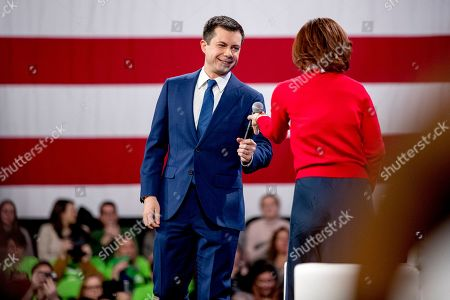 """Stock Image of Pete Buttigieg, Stephanie Ruhle. Democratic presidential candidate former South Bend, Ind., Mayor Pete Buttigieg joins Stephanie Ruhle of NBC News and MSNBC on stage at """"Our Rights, Our Courts"""" forum at New Hampshire Technical Institute's Concord Community College, in Concord, N.H"""
