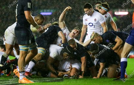 Tom Curry & Ben Youngs of England celebrates as Ellis Genge of England (bottom centre) scores the crucial match winning try