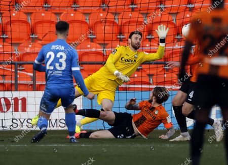 Oliver Dyson of Barrow is denied by Scott Loach (GK) during Barnet vs Barrow, Buildbase FA Trophy Football at the Hive Stadium on 8th February 2020