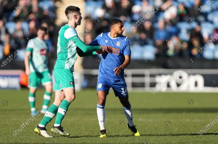 Brandon Comley of Colchester United and Ryan Hardie of Plymouth Argyle