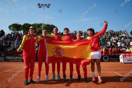 (L-R) Georgina Garcia Perez, Ana Isabel Medina Garrigues, Sara Sorribes Tormo, Aliona Bolsova, Lara Arruabarrena and Carla Suarez celebrate victory after the match.