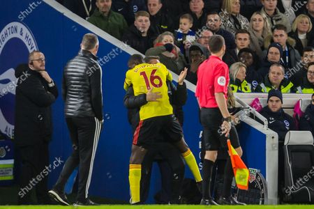 Abdoulaye Doucoure (Watford) celebrates his goal with Craig Shakespeare, Assistant Coach of Watford FC during the Premier League match between Brighton and Hove Albion and Watford at the American Express Community Stadium, Brighton and Hove