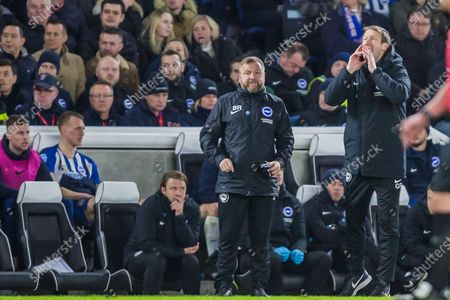 Billy Reid, Assistant Head Coach of Brighton & Hove Albion FC looks on as Graham Potter, Head Coach of Brighton & Hove Albion FC shouts instructions from the sidelines during the Premier League match between Brighton and Hove Albion and Watford at the American Express Community Stadium, Brighton and Hove