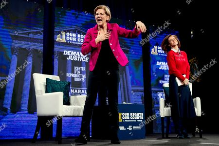 """Stock Photo of Elizabeth Warren, Stephanie Ruhle. Democratic presidential candidate Sen. Elizabeth Warren, D-Mass., left, accompanied by moderator Stephanie Ruhle of NBC News and MSNBC, right, waves after speaking at """"Our Rights, Our Courts"""" forum New Hampshire Technical Institute's Concord Community College, in Concord, N.H"""
