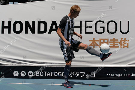 Japan's Keisuke Honda controls the ball during his official presentation as the newest member of the Botafogo soccer club, at Nilton Santos stadium in Rio de Janeiro, Brazil, . Honda, considered one of Japan's most successful players who played in the last three World Cups, has signed on to play for Botafogo